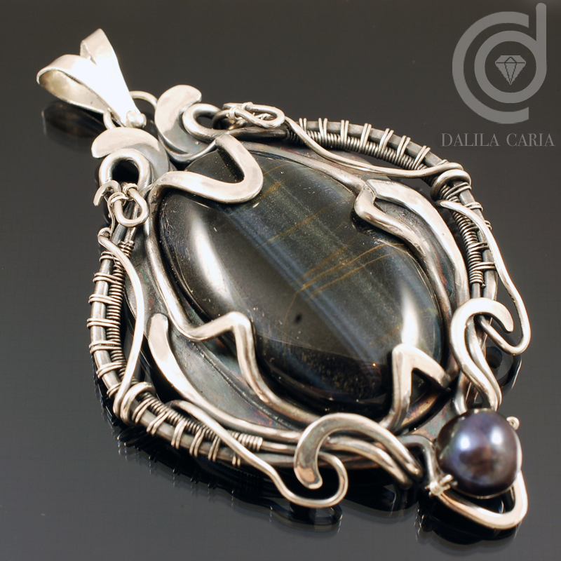Art nouveau silver pendant with hawk eye cab