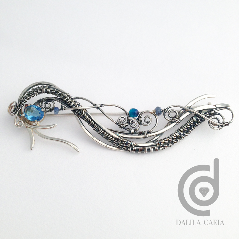Wavy silver pin with topaz