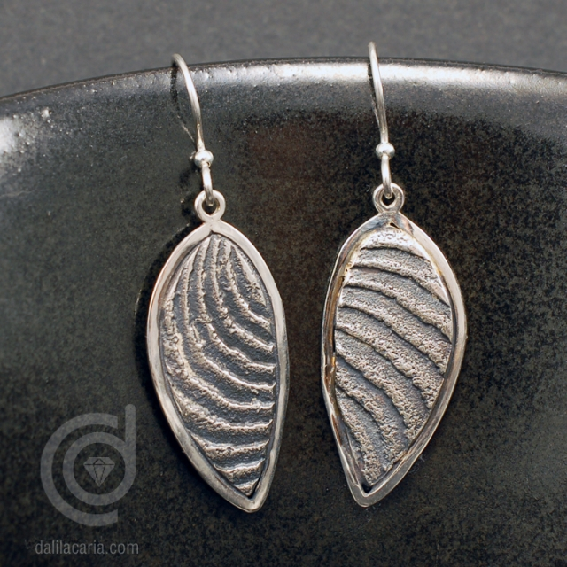 Silver cuttlefish cast earrings