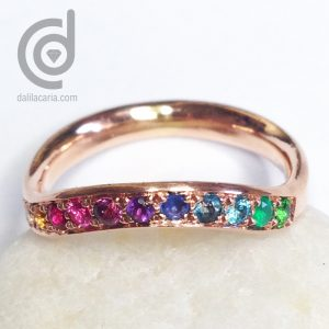 Gold wedding ring with gemstones