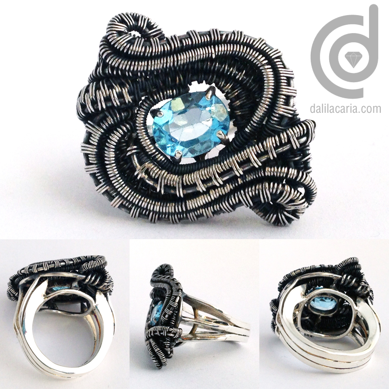 Silver ring with weaved decoration and topaz