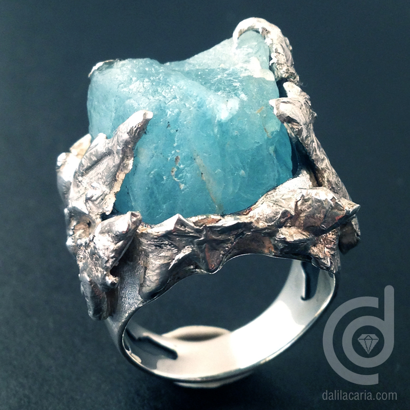 Silver ring with rough topaz