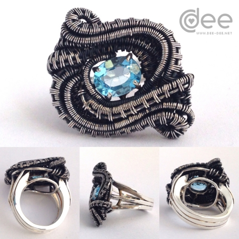 Silver and topaz ring with weaved decoration